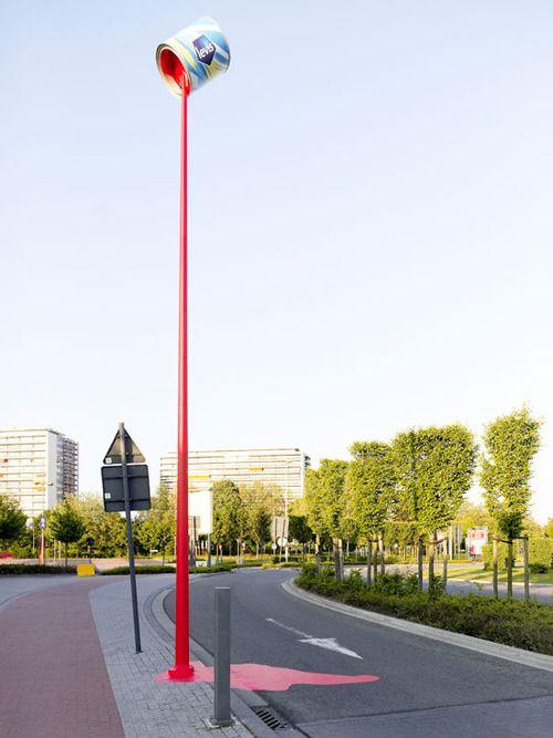 paint guerilla marketing on street lamp